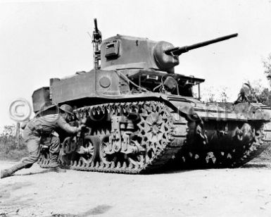 8e00123v__M3_Stuart_tank_on_maneuvers_with_U.S._Second_Army